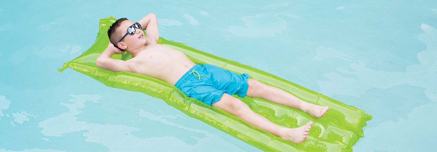 child lying on a floater in the pool at The Bard's Inn in Ashland, Oregon.